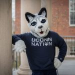 Jonathan Husky Mascot in navy blue UConn Nation Shirt