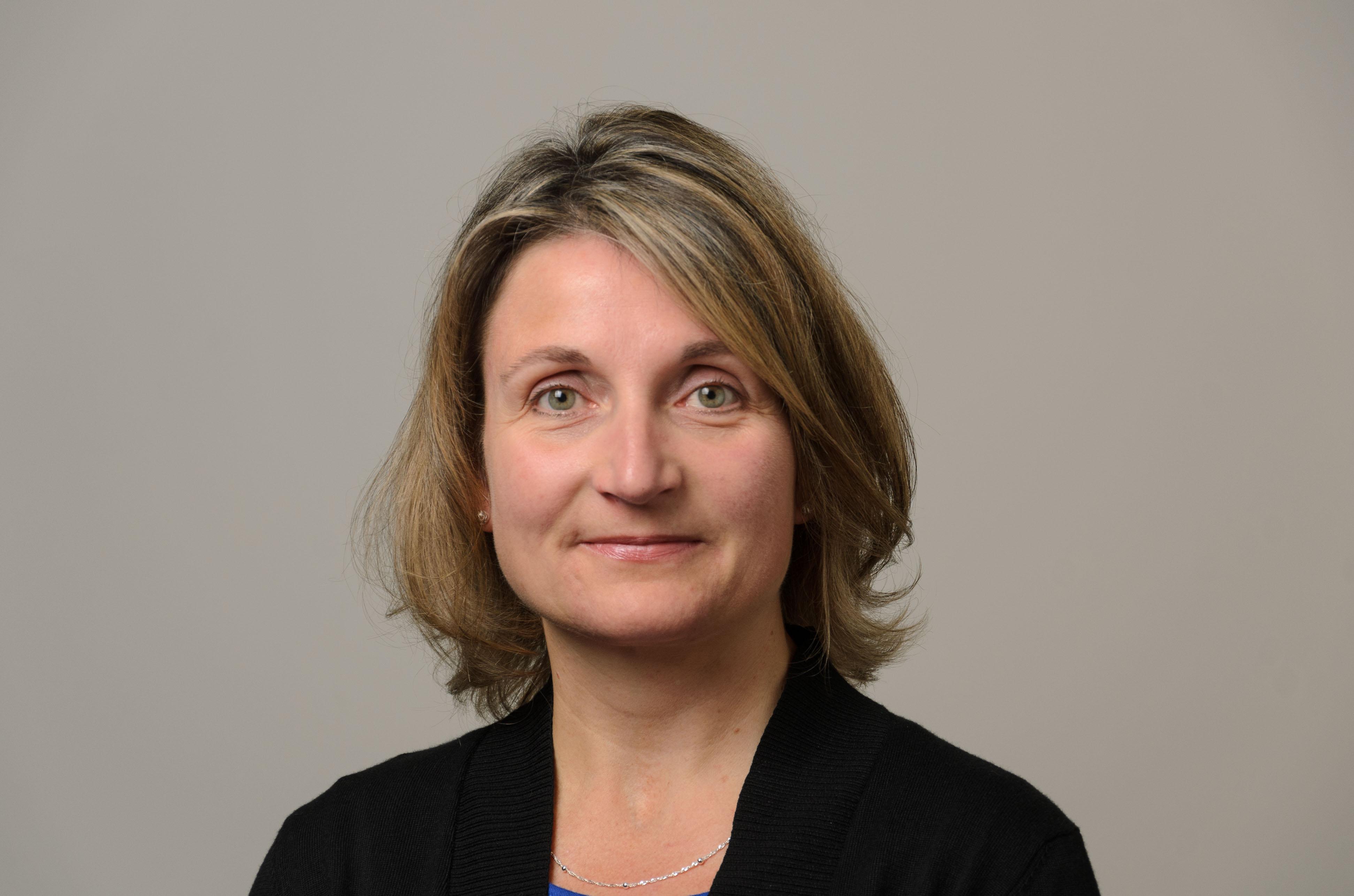 Headshot of Dawn Kemp. Black Shirt