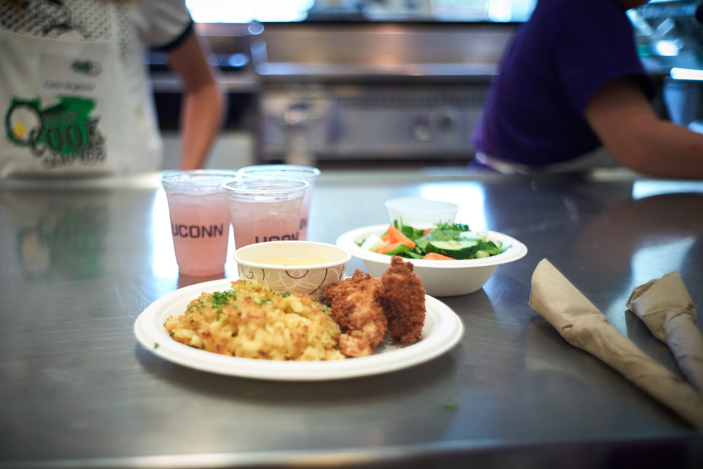 Mac 'n cheese, chicken nuggets, sauce and a vinaigrette salad was one team's entry during a competition at the UCann Cook Camp at Gelfenbien Commons